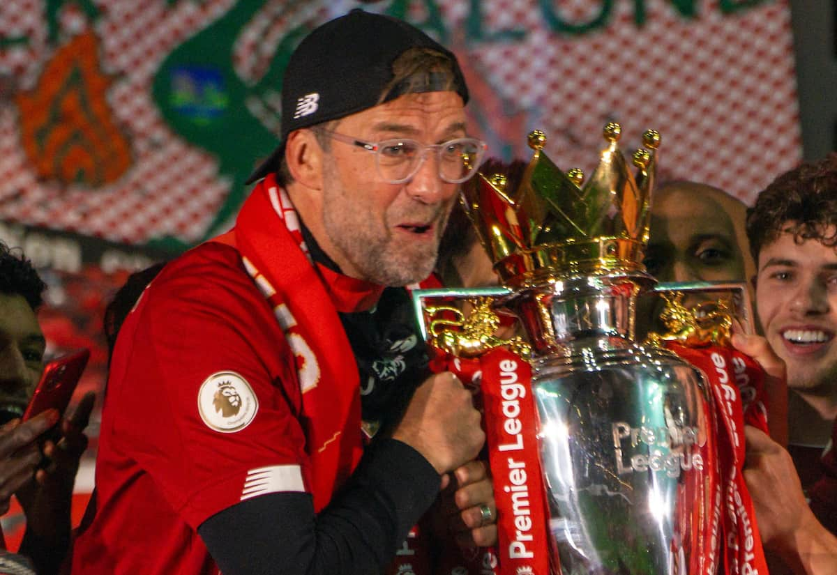 LIVERPOOL, ENGLAND - Wednesday, July 22, 2020: Liverpool's manager Jürgen Klopp (L) and Adam Lallana (R) lift the Premier League trophy during the presentation as the Reds are crowned Champions after the FA Premier League match between Liverpool FC and Chelsea FC at Anfield. The game was played behind closed doors due to the UK government's social distancing laws during the Coronavirus COVID-19 Pandemic. Also; Neco Williams, Mohamed Salah. (Pic by David Rawcliffe/Propaganda)