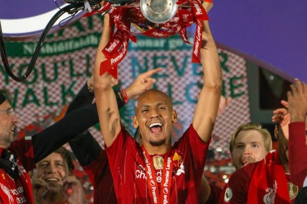 LIVERPOOL, ENGLAND - Wednesday, July 22, 2020: Liverpool's Fabio Henrique Tavares 'Fabinho' lifts the Premier League trophy during the presentation as the Reds are crowned Champions after the FA Premier League match between Liverpool FC and Chelsea FC at Anfield. The game was played behind closed doors due to the UK government's social distancing laws during the Coronavirus COVID-19 Pandemic. (Pic by David Rawcliffe/Propaganda)