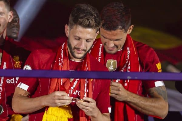 LIVERPOOL, ENGLAND - Wednesday, July 22, 2020: Liverpool's Adam Lallana looks at his winners' medal during the trophy presentation as the Reds are crowned Champions after the FA Premier League match between Liverpool FC and Chelsea FC at Anfield. The game was played behind closed doors due to the UK government's social distancing laws during the Coronavirus COVID-19 Pandemic. Roberto Firmino, Joel Matip, Dejan Lovren, goalkeeper Caoimhin Kelleher, Mohamed Salah, Georginio Wijnaldum, Virgil van Dijk, Joe Gomez. (Pic by David Rawcliffe/Propaganda)