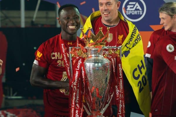 LIVERPOOL, ENGLAND - Wednesday, July 22, 2020: Liverpool's Naby Keita with the Premier League trophy as the Reds are crowned Champions after the FA Premier League match between Liverpool FC and Chelsea FC at Anfield. The game was played behind closed doors due to the UK government's social distancing laws during the Coronavirus COVID-19 Pandemic. (Pic by David Rawcliffe/Propaganda)