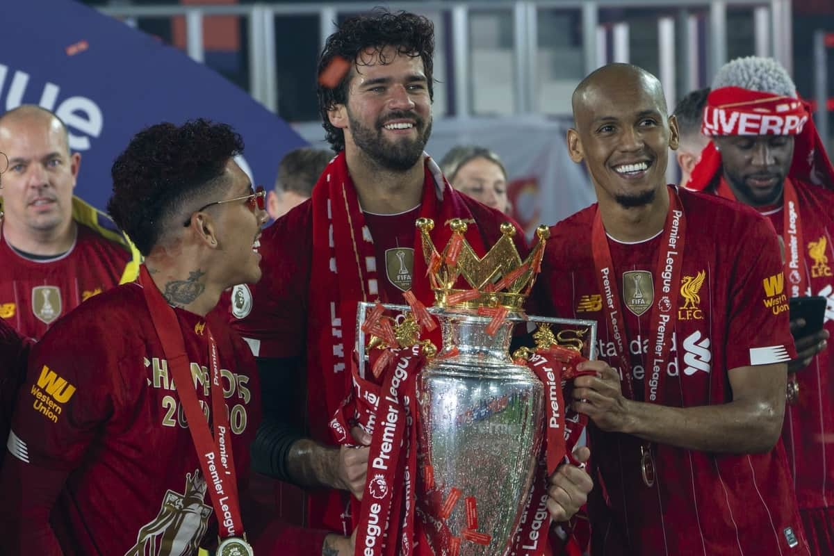 LIVERPOOL, ENGLAND - Wednesday, July 22, 2020: Liverpool's goalkeeper Alisson Becker (C) celebrates with team-mates Roberto Firmino (L) and Fabio Henrique Tavares 'Fabinho' (R) and the Premier League trophy as the Reds are crowned Champions after the FA Premier League match between Liverpool FC and Chelsea FC at Anfield. The game was played behind closed doors due to the UK government's social distancing laws during the Coronavirus COVID-19 Pandemic. (Pic by David Rawcliffe/Propaganda)