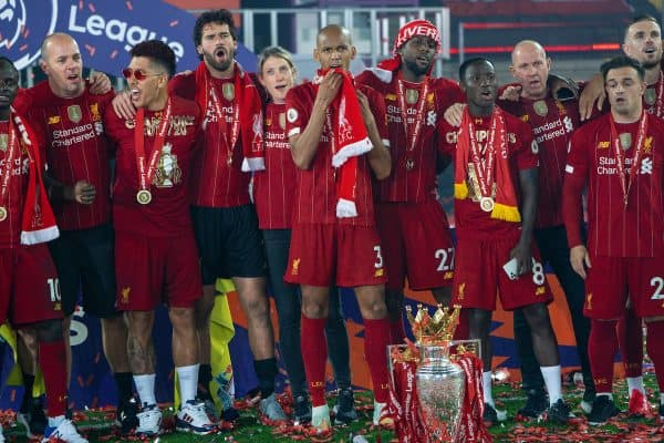 "LIVERPOOL, ENGLAND - Wednesday, July 22, 2020: Liverpool players celebrate with the Premier League trophy as they sing ""You'll Never Walk Alone"" after being crowned Champions after the FA Premier League match between Liverpool FC and Chelsea FC at Anfield. The game was played behind closed doors due to the UK government's social distancing laws during the Coronavirus COVID-19 Pandemic. Roberto Firmino, goalkeeper Alisson Becker, head of nutrition Mona Nemmer, Fabio Henrique Tavares 'Fabinho', Divock Origi, Naby Keita, Xherdan Shaqiri. (Pic by David Rawcliffe/Propaganda)"