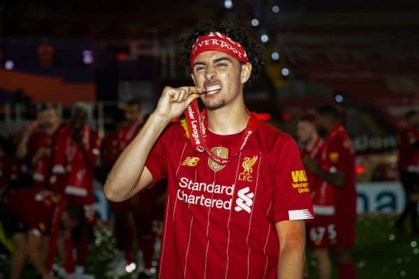 LIVERPOOL, ENGLAND - Wednesday, July 22, 2020: Liverpool's Curtis Jones bites his winners' medal after the Reds are crowned Champions after the FA Premier League match between Liverpool FC and Chelsea FC at Anfield. The game was played behind closed doors due to the UK government's social distancing laws during the Coronavirus COVID-19 Pandemic. Liverpool won 5-3. (Pic by David Rawcliffe/Propaganda)