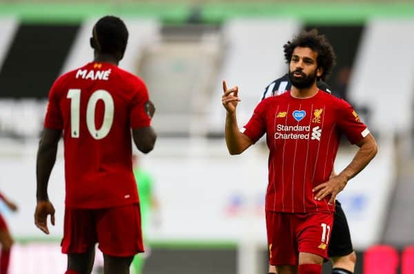 LIVERPOOL, ENGLAND - Sunday, July 26, 2020: Liverpool's Mohamed Salah (R) speaks with team-mate Sadio Mané during the final match of the FA Premier League season between Newcastle United FC and Liverpool FC at St. James' Park. The game was played behind closed doors due to the UK government's social distancing laws during the Coronavirus COVID-19 Pandemic. Liverpool won 3-1 and finished the season as Champions on 99 points. (Pic by Propaganda)