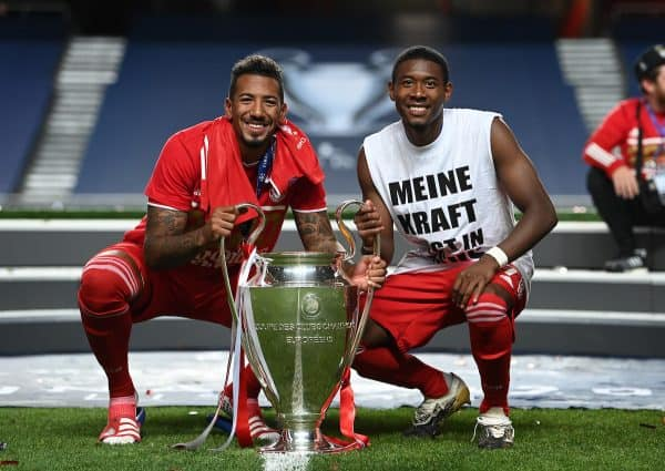 LISBON, PORTUGAL - Sunday, August 23, 2020: FC Bayern Munich's Jerome Boateng (L) and David Alaba celebrate with the European Cup trophy as Bayern win it for the sixth time after the UEFA Champions League Final between FC Bayern Munich and Paris Saint-Germain at the Estadio do Sport Lisboa e Benfica. FC Bayern Munich won 1-0. (Credit: ©UEFA)