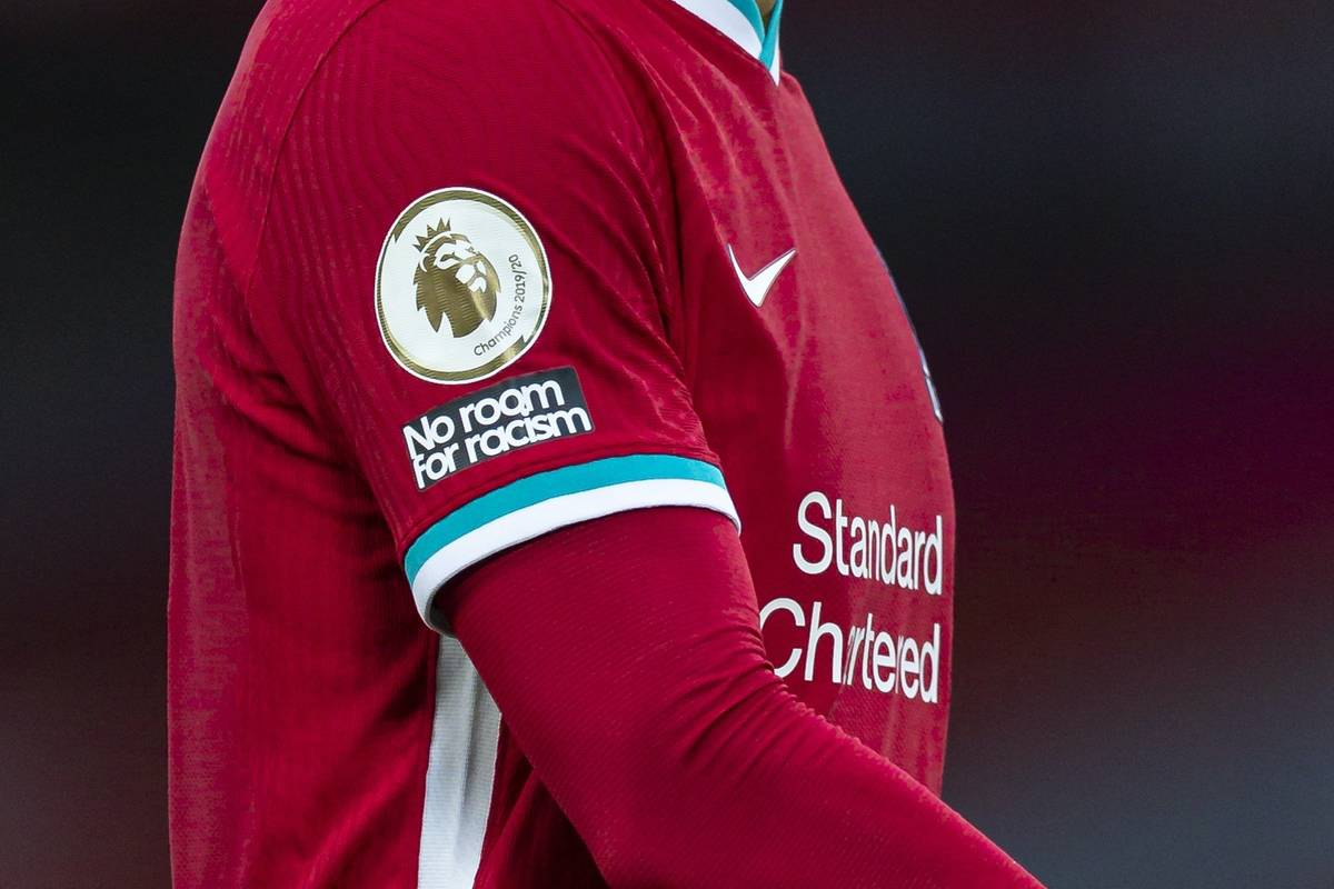 """LIVERPOOL, ENGLAND - Saturday, September 12, 2020: Liverpool's Virgil van Dijk, weraring a """"No Room for Racism"""" badge during the opening FA Premier League match between Liverpool FC and Leeds United FC at Anfield. The game was played behind closed doors due to the UK government's social distancing laws during the Coronavirus COVID-19 Pandemic. Liverpool won 4-3. (Pic by David Rawcliffe/Propaganda)"""