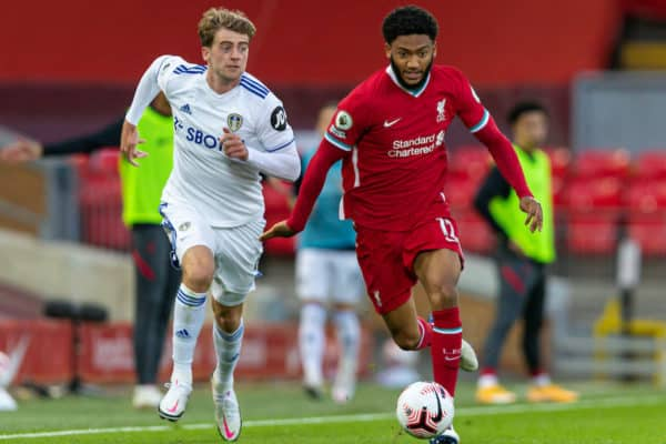 LIVERPOOL, ENGLAND - Saturday, September 12, 2020: Liverpool's Joe Gomez (R) is pulled back by Leeds United's Patrick Bamford during the opening FA Premier League match between Liverpool FC and Leeds United FC at Anfield. The game was played behind closed doors due to the UK government's social distancing laws during the Coronavirus COVID-19 Pandemic. Liverpool won 4-3. (Pic by David Rawcliffe/Propaganda)