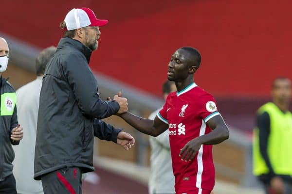 Liverpool's Naby Keita shakes hands with manager Jürgen Klopp as he is substituted during the opening FA Premier League match between Liverpool FC and Leeds United FC at Anfield. The game was played behind closed doors due to the UK government's social distancing laws during the Coronavirus COVID-19 Pandemic. Liverpool won 4-3. (Pic by David Rawcliffe/Propaganda)