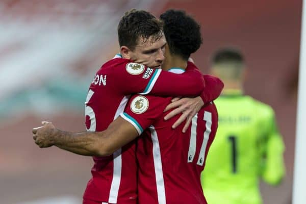 LIVERPOOL, ENGLAND - Saturday, September 12, 2020: Liverpool's Mohamed Salah (R) celebrates with team-mate Andy Robertson (L) after scoring the winning fourth goal, his hat-trick, from a penalty-kick to make the score 4-3 during the opening FA Premier League match between Liverpool FC and Leeds United FC at Anfield. The game was played behind closed doors due to the UK government's social distancing laws during the Coronavirus COVID-19 Pandemic. Liverpool won 4-3. (Pic by David Rawcliffe/Propaganda)