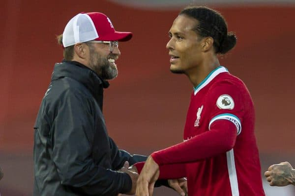 Liverpool's manager Jürgen Klopp with Virgil van Dijk after the opening FA Premier League match between Liverpool FC and Leeds United FC at Anfield. The game was played behind closed doors due to the UK government's social distancing laws during the Coronavirus COVID-19 Pandemic. Liverpool won 4-3. (Pic by David Rawcliffe/Propaganda)