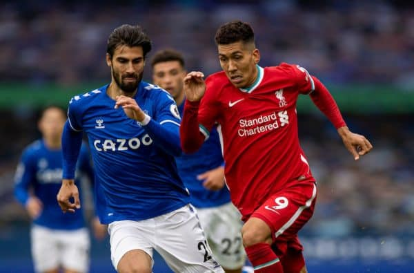 Liverpool's Roberto Firmino (R) gets away from Everton's André Gomes during the FA Premier League match between Everton FC and Liverpool FC, the 237th Merseyside Derby, at Goodison Park. The game was played behind closed doors due to the UK government's social distancing laws during the Coronavirus COVID-19 Pandemic. The game ended in a 2-2 draw. (Pic by David Rawcliffe/Propaganda)