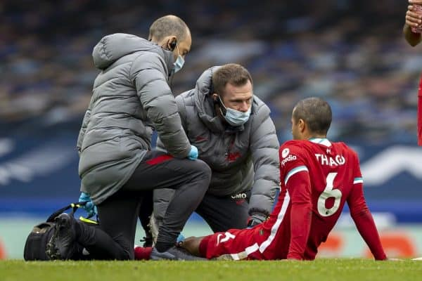 LIVERPOOL, ENGLAND - Saturday, October 17, 2020: Liverpool's Thiago Alcantara is treated for an injury by physio Chris Morgan and club doctor Jim Moxon during the FA Premier League match between Everton FC and Liverpool FC, the 237th Merseyside Derby, at Goodison Park. The game was played behind closed doors due to the UK government's social distancing laws during the Coronavirus COVID-19 Pandemic. The game ended in a 2-2 draw. (Pic by David Rawcliffe/Propaganda)