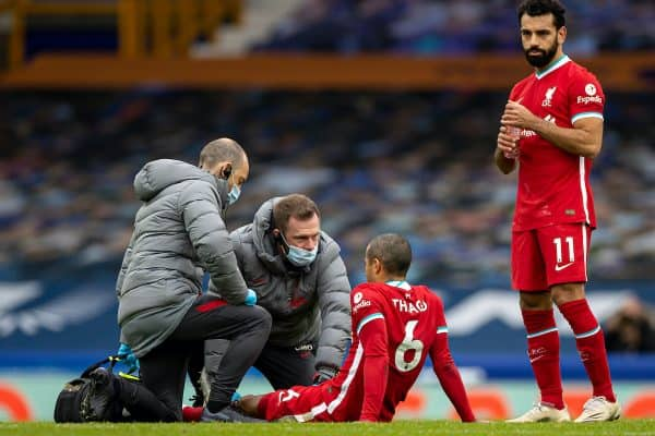 LIVERPOOL, ENGLAND - Saturday, October 17, 2020: Liverpool's Thiago Alcantara is treated for an injury by physio Chris Morgan during the FA Premier League match between Everton FC and Liverpool FC, the 237th Merseyside Derby, at Goodison Park. The game was played behind closed doors due to the UK government's social distancing laws during the Coronavirus COVID-19 Pandemic. The game ended in a 2-2 draw. (Pic by David Rawcliffe/Propaganda)