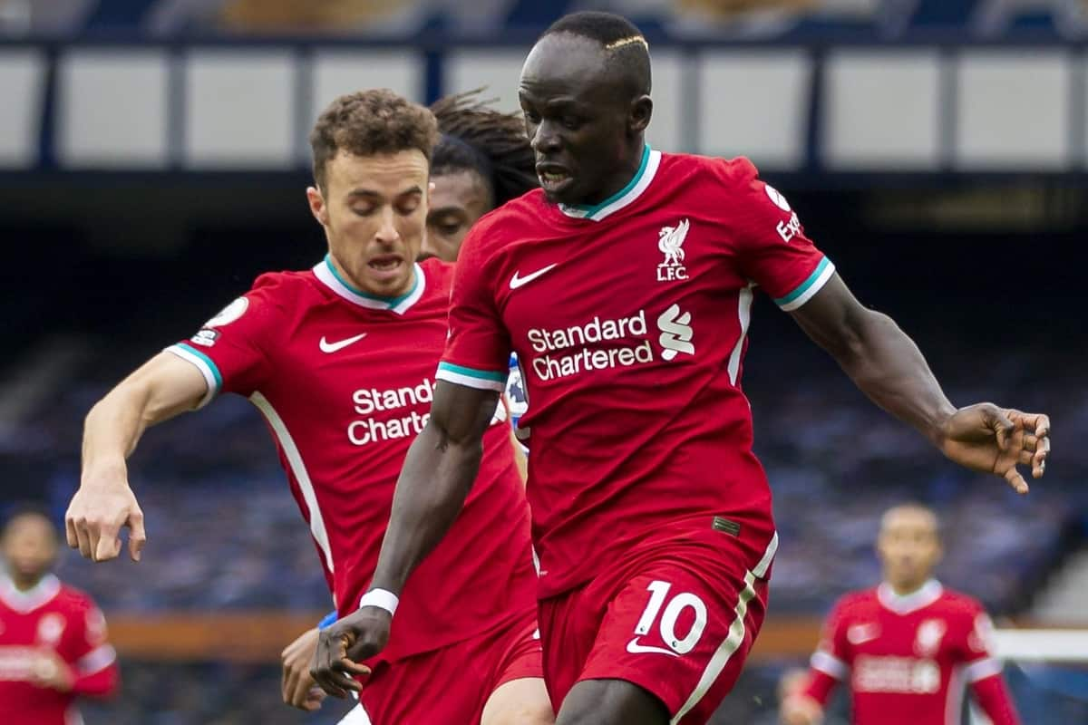 LIVERPOOL, ENGLAND - Saturday, October 17, 2020: Liverpool's Diogo Jota (L) and Sadio Mané challenge for the ball during the FA Premier League match between Everton FC and Liverpool FC, the 237th Merseyside Derby, at Goodison Park. The game was played behind closed doors due to the UK government's social distancing laws during the Coronavirus COVID-19 Pandemic. The game ended in a 2-2 draw. (Pic by David Rawcliffe/Propaganda)