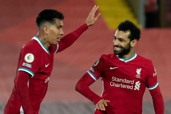 LIVERPOOL, ENGLAND - Saturday, October 24, 2020: Liverpool's Roberto Firmino (L) celebrates with team-mate Mohamed Salah (R) after the equalising goal from a rebound to level the score at 1-1 during the FA Premier League match between Liverpool FC and Sheffield United FC at Anfield. The game was played behind closed doors due to the UK government's social distancing laws during the Coronavirus COVID-19 Pandemic. (Pic by Propaganda)