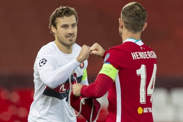 LIVERPOOL, ENGLAND - Tuesday, October 27, 2020: FC Midtjylland's captain Erik Sviatchenko (L) and Liverpool's captain Jordan Henderson before the UEFA Champions League Group D match between Liverpool FC and FC Midtjylland at Anfield. Liverpool won 2-0. (Pic by David Rawcliffe/Propaganda)