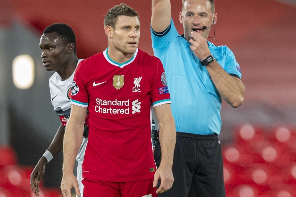 LIVERPOOL, ENGLAND - Tuesday, October 27, 2020: Liverpool's James Milner is shown a yellow card by referee Pawe? Raczkowski during the UEFA Champions League Group D match between Liverpool FC and FC Midtjylland at Anfield. Liverpool won 2-0. (Pic by David Rawcliffe/Propaganda)