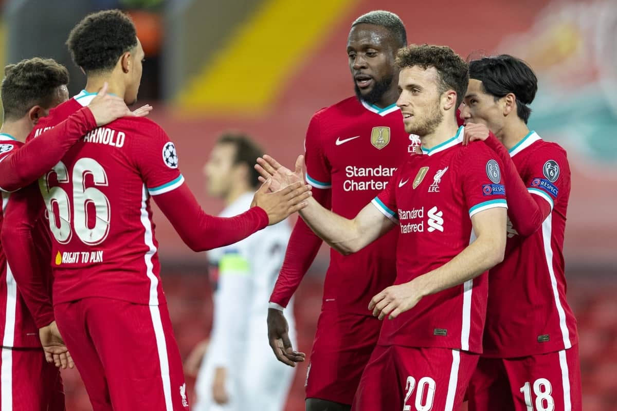 LIVERPOOL, ENGLAND - Tuesday, October 27, 2020: Liverpool's Diogo Jota (C) celebrates with team-mates Divock Origi and Takumi Minamino after scoring the first goal, the club's 10,000th goal, during the UEFA Champions League Group D match between Liverpool FC and FC Midtjylland at Anfield. Liverpool won 2-0. (Pic by David Rawcliffe/Propaganda)