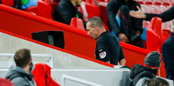 LIVERPOOL, ENGLAND - Saturday, October 31, 2020: Referee Kevin Friend reviews an incident on the VAR screen before disallowing a Liverpool goal during the FA Premier League match between Liverpool FC and West Ham United FC at Anfield. The game was played behind closed doors due to the UK government's social distancing laws during the Coronavirus COVID-19 Pandemic. (Pic by Propaganda)