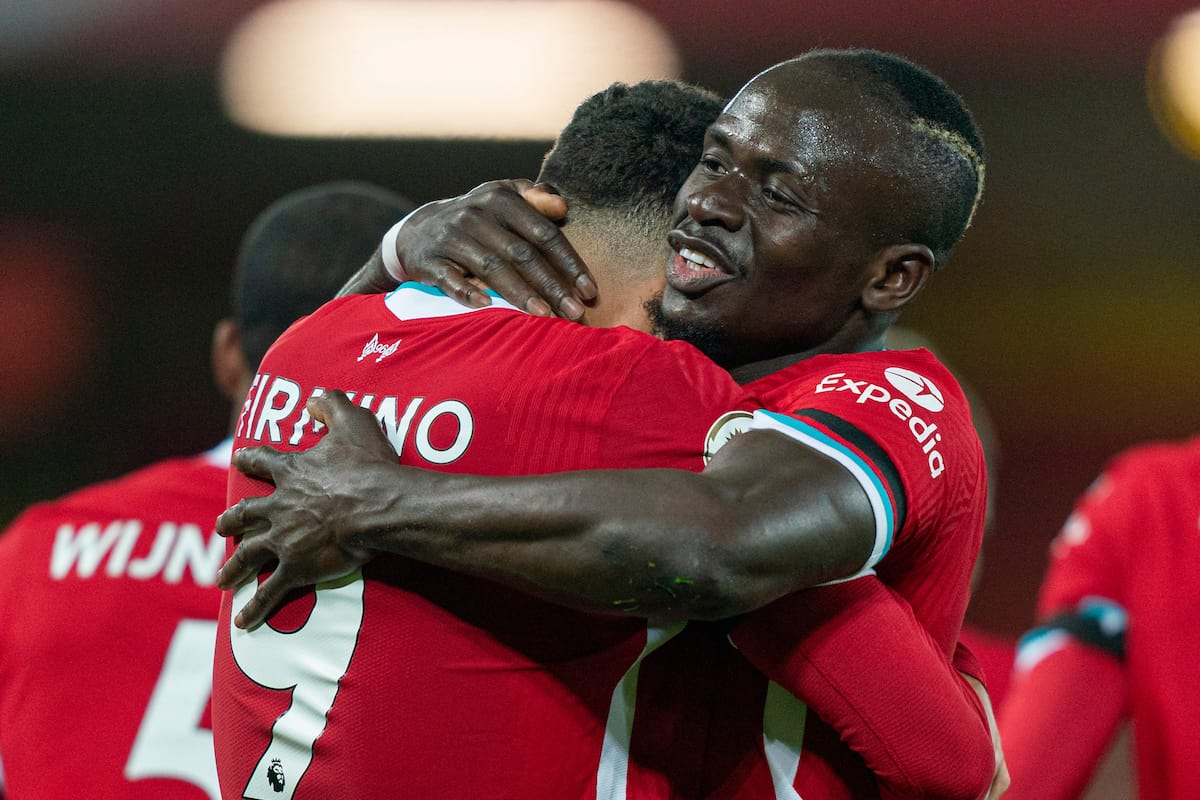 LIVERPOOL, ENGLAND - Sunday, November 22, 2020: Liverpool's Roberto Firmino (L) celebrates with team-mate Sadio Mané after scoring the third goal during the FA Premier League match between Liverpool FC and Leicester City FC at Anfield. The game was played behind closed doors due to the UK government's social distancing laws during the Coronavirus COVID-19 Pandemic. Liverpool won 3-0. (Pic by David Rawcliffe/Propaganda)