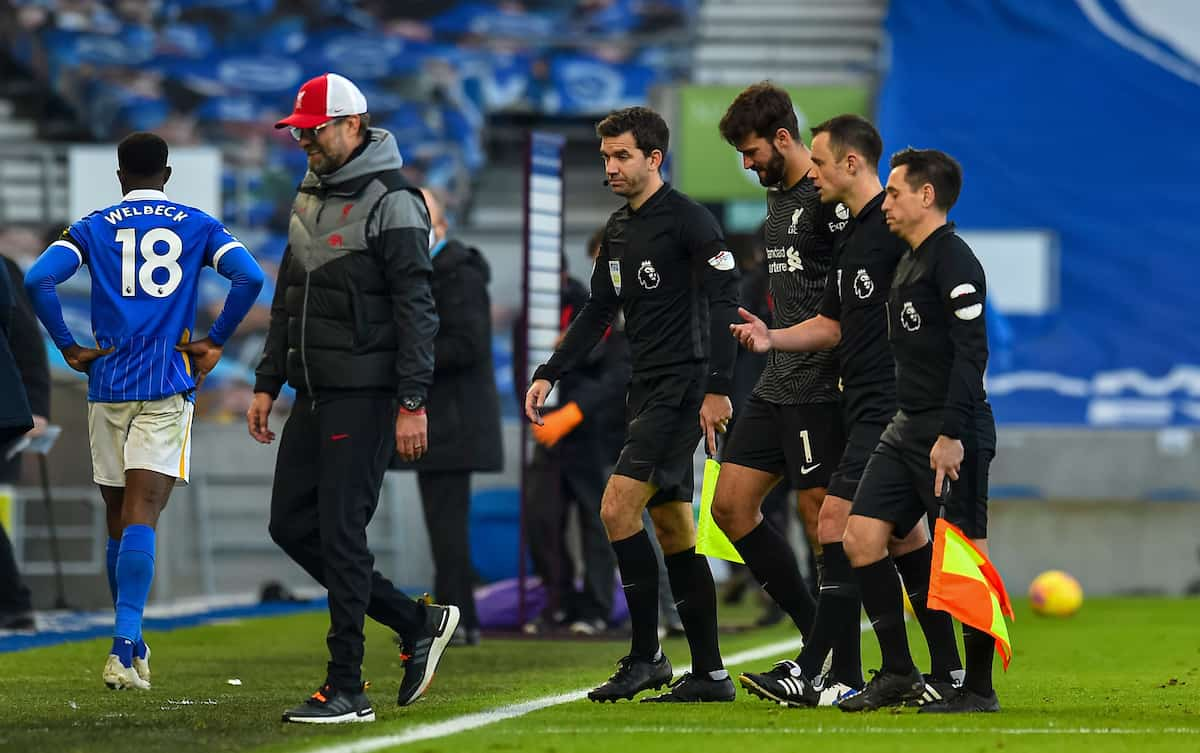 BRIGHTON & HOVE, ENGLAND - Saturday, November 28, 2020: Liverpool's goalkeeper Alisson Becker speaks with referee Stuart Atwell after the FA Premier League match between Brighton & Hove Albion FC and Liverpool FC at the AMEX Stadium. The game was played behind closed doors due to the UK government's social distancing laws during the Coronavirus COVID-19 Pandemic. (Pic by Propaganda)