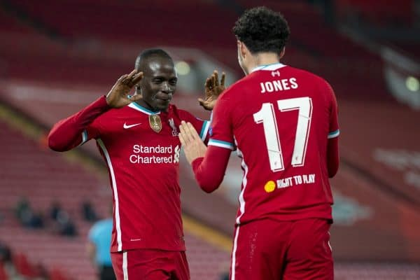 LIVERPOOL, ENGLAND - Tuesday, December 1, 2020: Liverpool's Curtis Jones (R) celebrates with team-mate Sadio Mané (L) after scoring the only goal of the game during the UEFA Champions League Group D match between Liverpool FC and AFC Ajax at Anfield. Liverpool won 1-0 to win the group and progress to the Round of 16. (Pic by David Rawcliffe/Propaganda)
