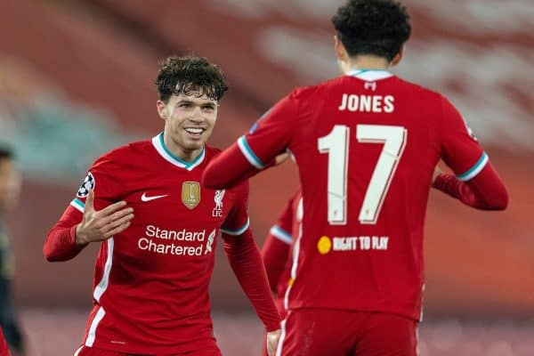 LIVERPOOL, ENGLAND - Tuesday 1 December 2020: Curtis Jones (R) of Liverpool celebrates with teammate Neco Williams after scoring the only goal of the game during the Group D match of the UEFA Champions League final between Liverpool FC and AFC Ajax at Anfield.  Liverpool won 1-0 to win the group and qualify for the knockout stages (Photo by David Rawcliffe / Propaganda)