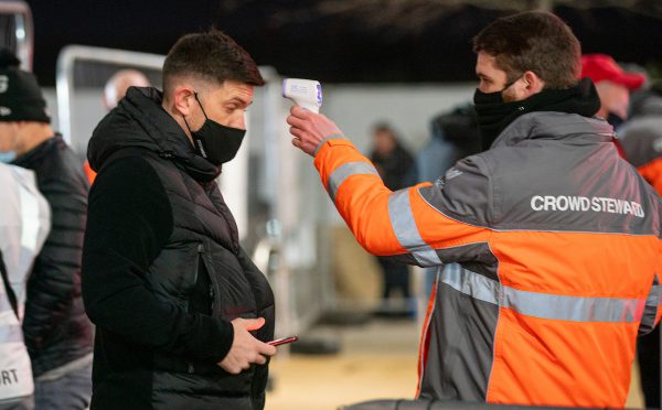 LIVERPOOL, ENGLAND - Sunday, December 6, 2020: A Liverpool supporter has his temperature checked as the club welcomes 2,000 spectators back into the stadium, pictured before the FA Premier League match between Liverpool FC and Wolverhampton Wanderers FC at Anfield. Liverpool won 4-0. (Pic by David Rawcliffe/Propaganda)