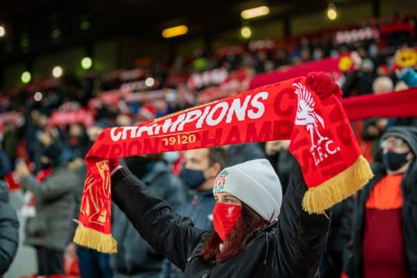 "LIVERPOOL, ENGLAND - Sunday, December 6, 2020: Liverpool supporters on the Spion Kop sing ""You'll Never Walk Alone"" before the FA Premier League match between Liverpool FC and Wolverhampton Wanderers FC at Anfield. Liverpool won 4-0. (Pic by David Rawcliffe/Propaganda)"