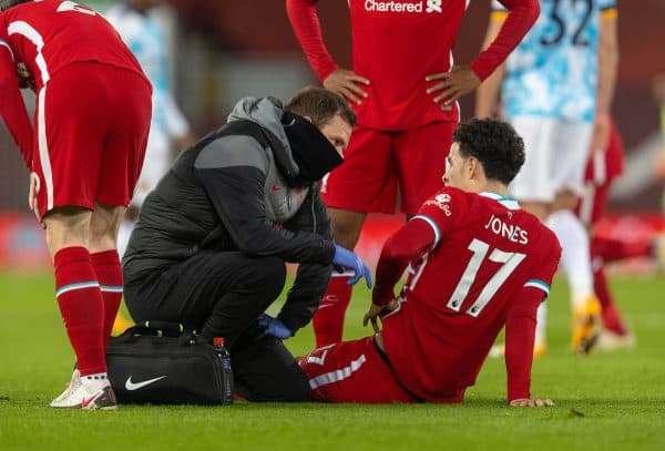 LIVERPOOL, ENGLAND - Sunday, December 6, 2020: Liverpool's Curtis Jones receives treatment from physio Chris Morgan during the FA Premier League match between Liverpool FC and Wolverhampton Wanderers FC at Anfield. Liverpool won 4-0. (Pic by David Rawcliffe/Propaganda)