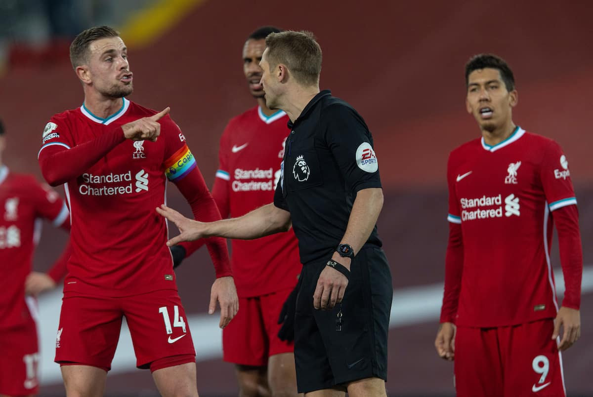 LIVERPOOL, ENGLAND - Sunday, December 6, 2020: Liverpool's captain Jordan Henderson remonstrates with referee Craig Pawson after he awaded Wolverhampton Wanderers a penalty, the decision was later overturned when the referee looked at a replay on the VAR monitor, during the FA Premier League match between Liverpool FC and Wolverhampton Wanderers FC at Anfield. Liverpool won 4-0. (Pic by David Rawcliffe/Propaganda)