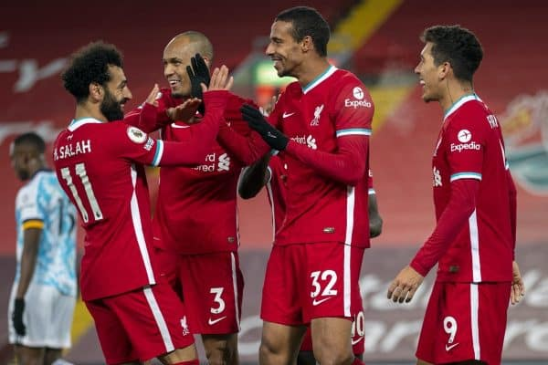 LIVERPOOL, ENGLAND - Sunday, December 6, 2020: Liverpool's Joel Matip (2nd from R) celebrates with team-mates Mohamed Salah, Fabio Henrique Tavares 'Fabinho' and Roberto Firmino after scoring the third goal during the FA Premier League match between Liverpool FC and Wolverhampton Wanderers FC at Anfield. Liverpool won 4-0. (Pic by David Rawcliffe/Propaganda)