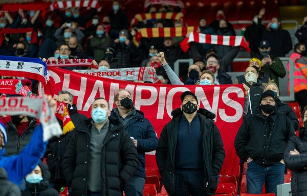 "LIVERPOOL, ENGLAND - Wednesday, December 16, 2020: Liverpool supporters sing ""You'll Never Walk Alone"" on the Spion Kop before the FA Premier League match between Liverpool FC and Tottenham Hotspur FC at Anfield. Liverpool won 2-1. (Pic by David Rawcliffe/Propaganda)"