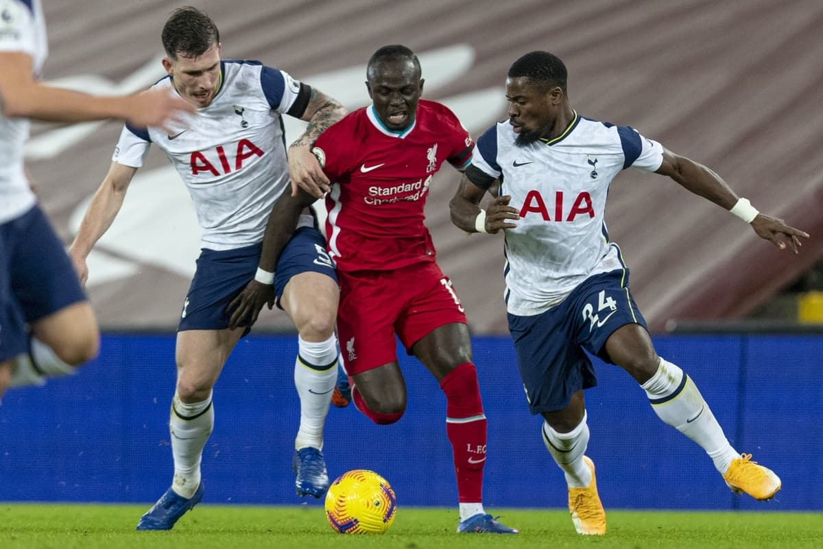 LIVERPOOL, ENGLAND - Wednesday, December 16, 2020: Liverpool's Sadio Mané is tackled by Tottenham Hotspur's Pierre-Emile Højbjerg (L) and Serge Aurier (R) during the FA Premier League match between Liverpool FC and Tottenham Hotspur FC at Anfield. Liverpool won 2-1. (Pic by David Rawcliffe/Propaganda)