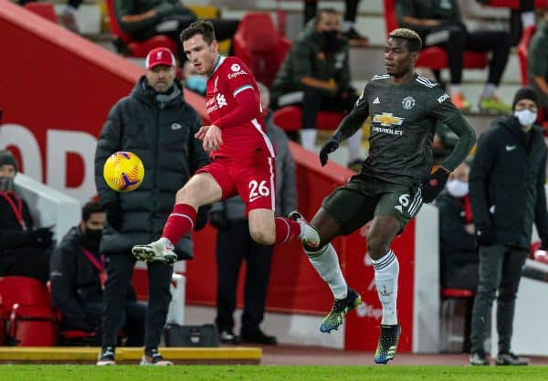 LIVERPOOL, ENGLAND - Sunday, January 17, 2021: Liverpool's Andy Robertson (L) and Manchester United's Paul Pogba during the FA Premier League match between Liverpool FC and Manchester United FC at Anfield. The game ended in a 0-0 draw. (Pic by David Rawcliffe/Propaganda)