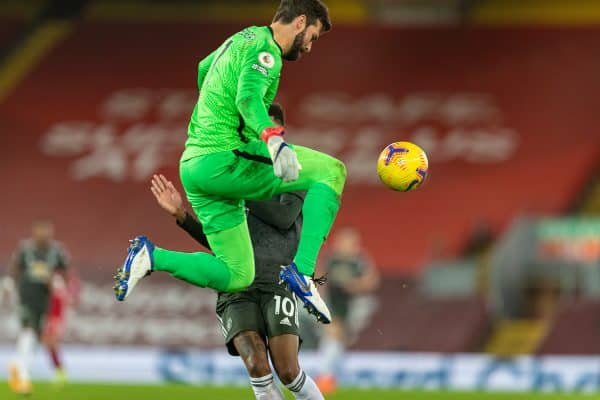 LIVERPOOL, ENGLAND - Sunday, January 17, 2021: Liverpool's goalkeeper Alisson Becker intercepts the ball from Manchester United's Marcus Rashford during the FA Premier League match between Liverpool FC and Manchester United FC at Anfield. The game ended in a 0-0 draw. (Pic by David Rawcliffe/Propaganda)