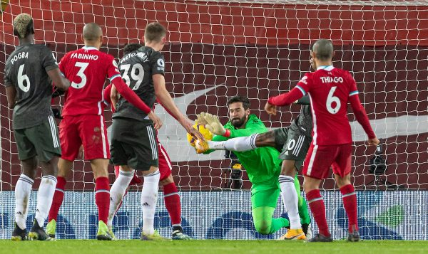 LIVERPOOL, ENGLAND - Sunday, January 17, 2021: Liverpool's goalkeeper Alisson Becker makes a save during the FA Premier League match between Liverpool FC and Manchester United FC at Anfield. The game ended in a 0-0 draw. (Pic by David Rawcliffe/Propaganda)