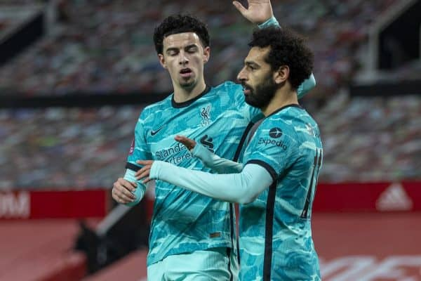 Liverpool's Mohamed Salah (R) celebrates after scoring the first goal with team-mate Curtis Jones (L) during the FA Cup 4th Round match between Manchester United FC and Liverpool FC at Old Trafford. Manchester United won 3-2. (Pic by David Rawcliffe/Propaganda)