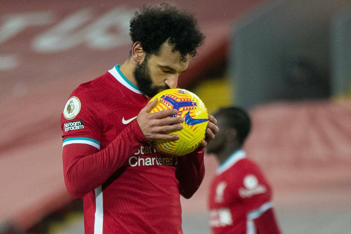 LIVERPOOL, ENGLAND - Sunday, February 7, 2021: Liverpool's Mohamed Salah kisses the ball before scoring the first equalising goal from a penalty kick during the FA Premier League match between Liverpool FC and Manchester City FC at Anfield. Manchester City won 4-1. (Pic by David Rawcliffe/Propaganda)