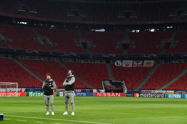 BUDAPEST, HUNGARY - Tuesday, February 16, 2021: Liverpool's Kostas Tsimikas (L) and goalkeeper Alisson Becker inspect the pitch before the UEFA Champions League Round of 16 1st Leg game between RB Leipzig and Liverpool FC at the Puskás Aréna. (Pic by Propaganda)