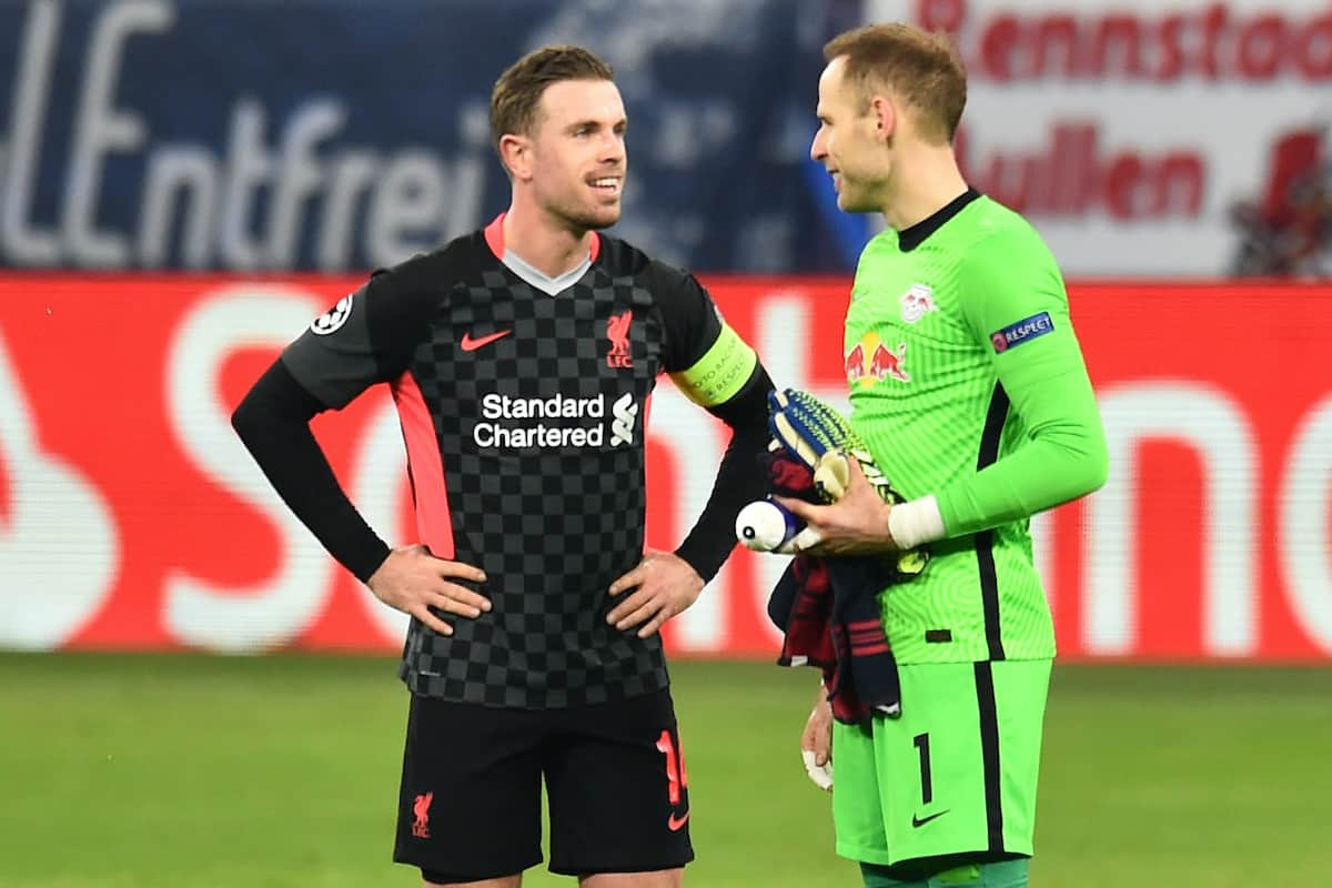 BUDAPEST, HUNGARY - Tuesday, February 16, 2021: Liverpool's captain Jordan Henderson (L) and RB Leipzig's goalkeeper Pe?ter Gula?csi after the UEFA Champions League Round of 16 1st Leg game between RB Leipzig and Liverpool FC at the Puskás Aréna. (Pic by Propaganda)