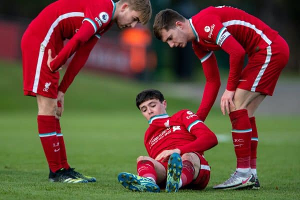 KIRKBY, ENGLAND - Saturday, March 13, 2021: Liverpool's Layton Stewart (C) goes down injured as Jake Cain (L) and captain Ben Woodburn (R) look on during the Premier League 2 Division 1 match between Liverpool FC Under-23's and West Ham United FC Under-23's at the Liverpool Academy. The game ended in a 1-1 draw. (Pic by David Rawcliffe/Propaganda)