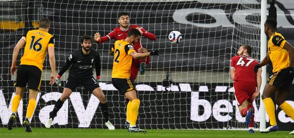 WOLVERHAMPTON, ENGLAND - Monday, March 15, 2021: Liverpool's Ozan Kabak clears the ball during the FA Premier League match between Wolverhampton Wanderers FC and Liverpool FC at Molineux Stadium. Liverpool won 1-0. (Pic by Propaganda)