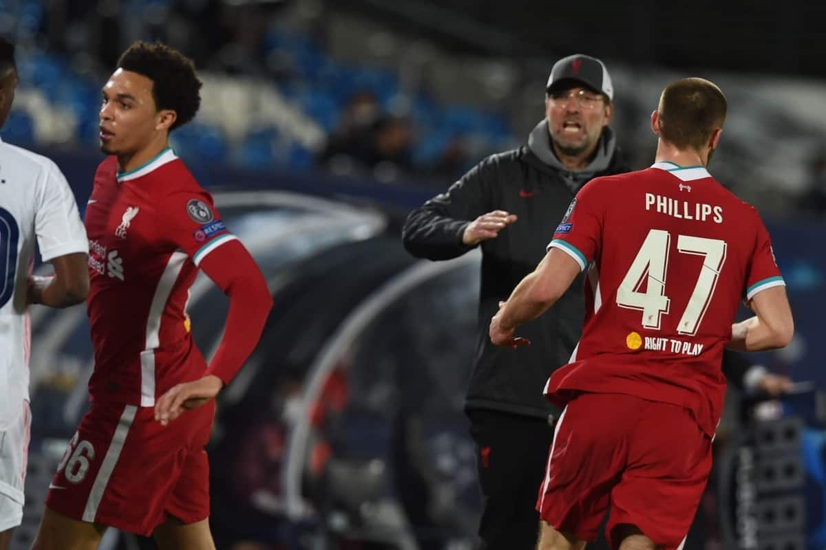 MADRID, SPAIN - Tuesday, April 6, 2021: Real Madrid's Vini?cius Ju?nior clashes with Liverpool's Trent Alexander-Arnold during the UEFA Champions League Quarter-Final 1st Leg game between Real Madird CF and Liverpool FC at the Estadio Alfredo Di Stefano. (Pic by Propaganda)