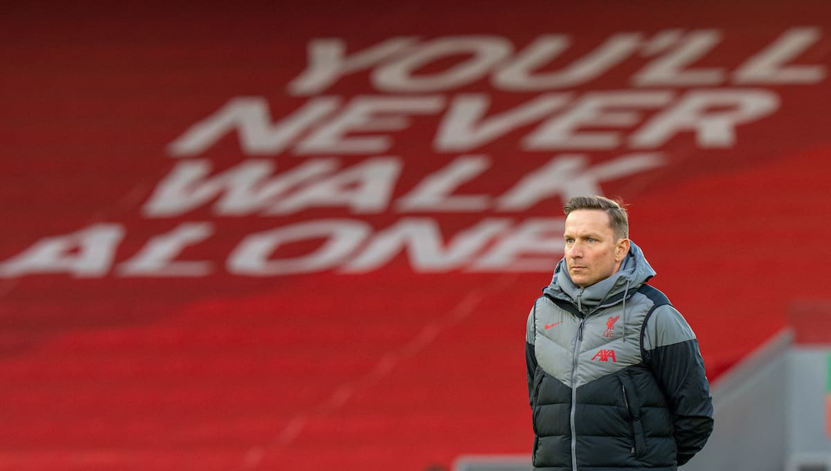 """LIVERPOOL, ENGLAND - Wednesday, April 14, 2021: """"You'll Never Walk Alone"""" Liverpool's first-team development coach Pepijn Lijnders during the pre-match warm-up before the UEFA Champions League Quarter-Final 2nd Leg game between Liverpool FC and Real Madird CF at Anfield. The game ended in a goal-less draw, Real Madrid won 3-1 on aggregate. (Pic by David Rawcliffe/Propaganda)"""