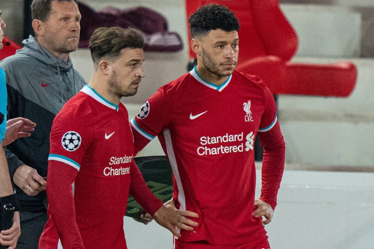 LIVERPOOL, ENGLAND - Wednesday, April 14, 2021: Liverpool's substitutes Xherdan Shaqiri (L) and Alex Oxlade-Chamberlain prepare to come on during the UEFA Champions League Quarter-Final 2nd Leg game between Liverpool FC and Real Madird CF at Anfield. The game ended in a goal-less draw, Real Madrid won 3-1 on aggregate. (Pic by David Rawcliffe/Propaganda)