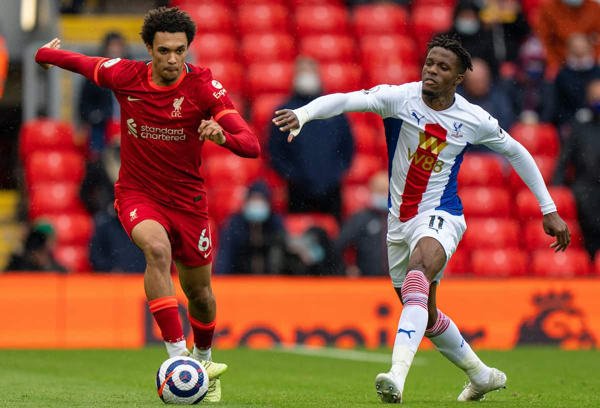 LIVERPOOL, ENGLAND - Sunday, May 23, 2021: Liverpool's Trent Alexander-Arnold (L) gets away from Crystal Palace's Wilfried Zaha during the final FA Premier League match between Liverpool FC and Crystal Palace FC at Anfield. Liverpool won 2-0 and finished 3rd in the table. (Pic by David Rawcliffe/Propaganda)