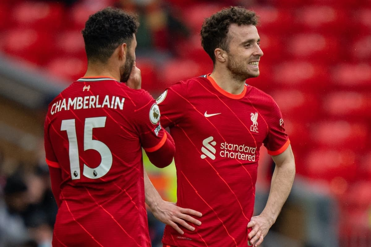LIVERPOOL, ENGLAND - Sunday, May 23, 2021: Liverpool substitutes Alex Oxlade-Chamberlain (L) and Diogo Jota prepare to come on during the final FA Premier League match between Liverpool FC and Crystal Palace FC at Anfield. Liverpool won 2-0 and finished 3rd in the table. (Pic by David Rawcliffe/Propaganda)