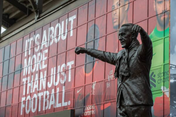 """LIVERPOOL, ENGLAND - Sunday, August 8, 2021: A statue of former Liverpool manager Bill Shankly in front of branding """"It's about more than just football"""" pictured before a pre-season friendly match between Liverpool FC and Athletic Club de Bilbao at Anfield. The game ended in a 1-1 draw. (Pic by David Rawcliffe/Propaganda)"""