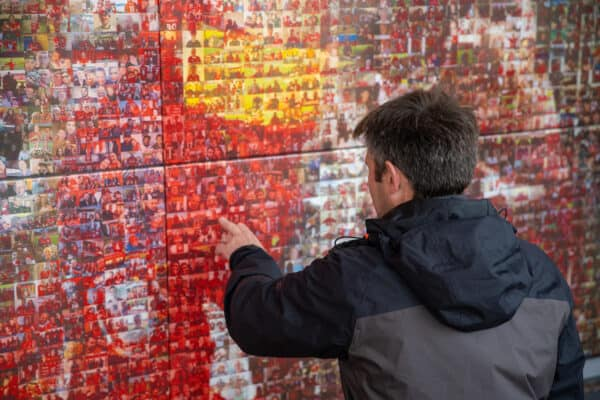 LIVERPOOL, ENGLAND - Sunday, August 8, 2021: A supporter looks at photograophs on the Champions Wall before a pre-season friendly match between Liverpool FC and Athletic Club de Bilbao at Anfield. The game ended in a 1-1 draw. (Pic by David Rawcliffe/Propaganda)